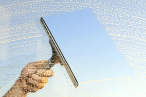 Clean Home Windows with a Squeegee